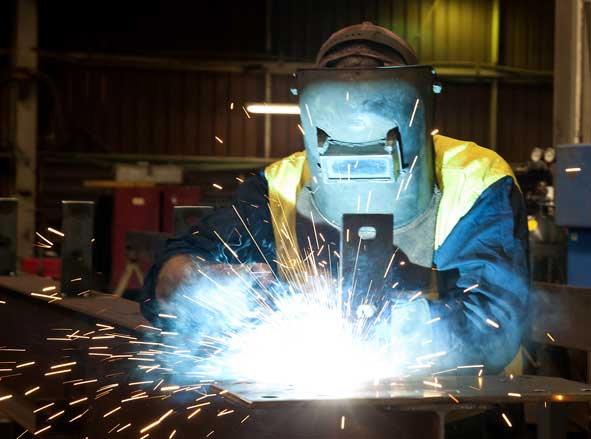 Photo of a welder at work